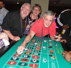 Casino Night fun with Michael Deihl, Cheryl Glass, and Tom McAdams